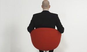 Businessman sitting in modern office chair --- Image by © Klaus Tiedge/Corbis